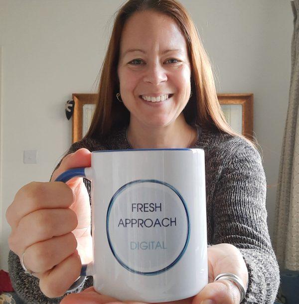 White fresh approach digital mug held by owner